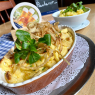 Allgäu cheese spaetzle with spicy mountain cheese, Emmental cheese and melted onions, with a small side salad